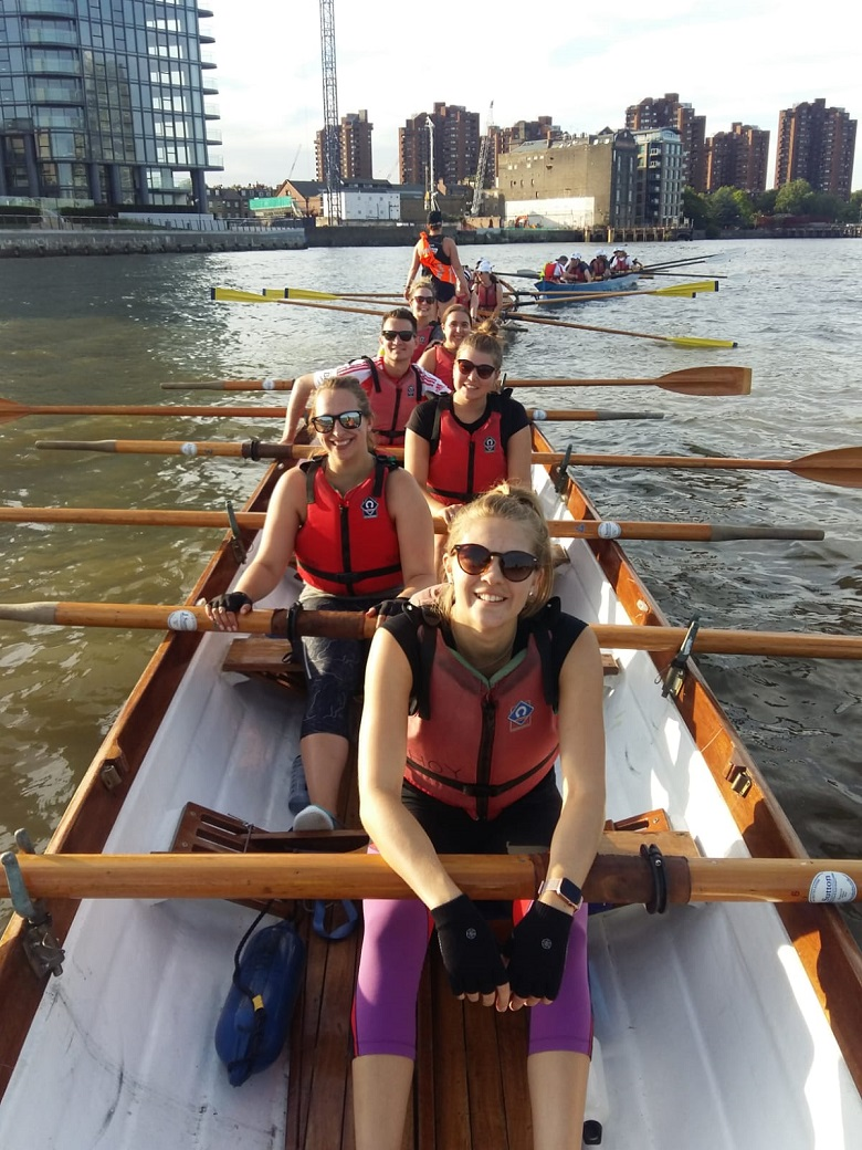 The team of charity rowers on the water