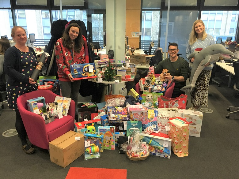 Thames Water staff with the pile of toys for donation