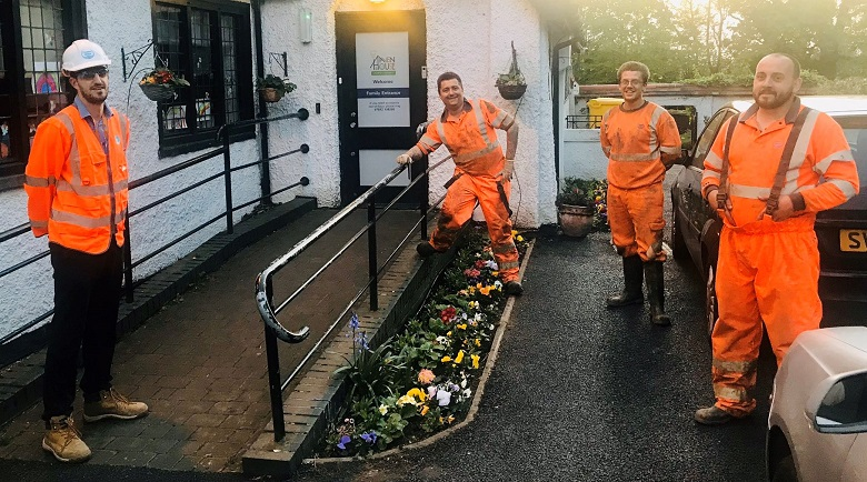 Thames Water engineers standing outside the hospice