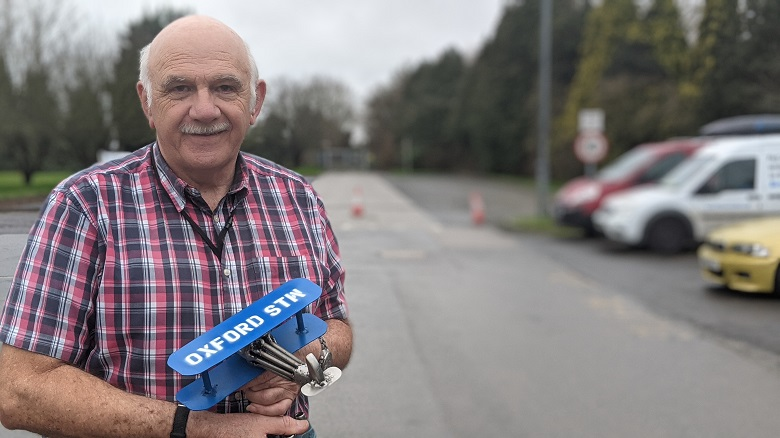 Bob Steptoe retires from Oxford sewage works with a model plane made for him by colleague