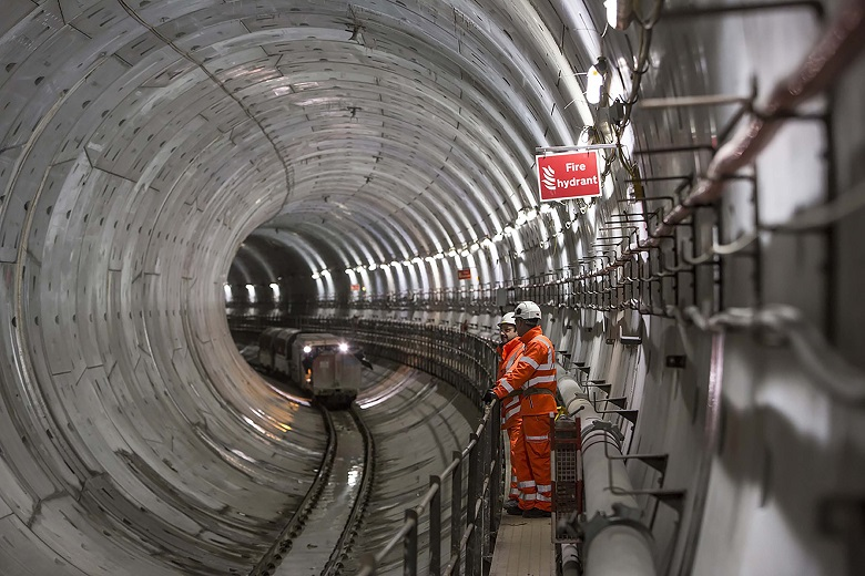 Two Thames Water engineers inside a tunnel