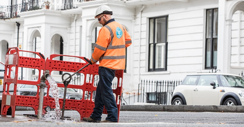 A Thames Water engineer carrying out work on a London street