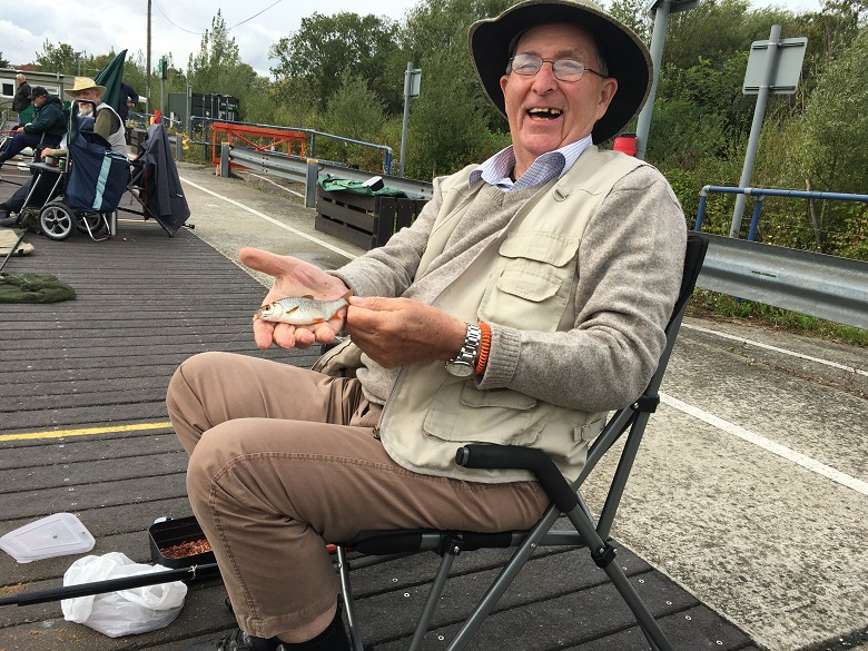 A Chelsea Pensioner catches a fish at Walthamstow Wetlands