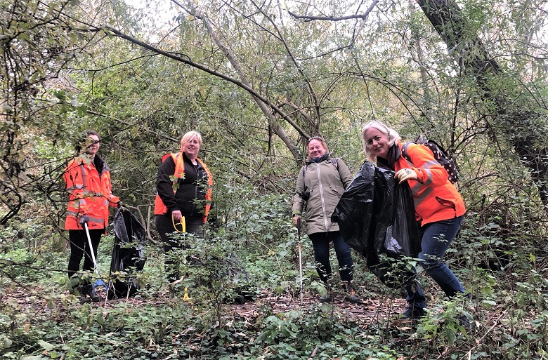 Thames Water volunteers picking litter at Fobney Lock and Nature Reserve