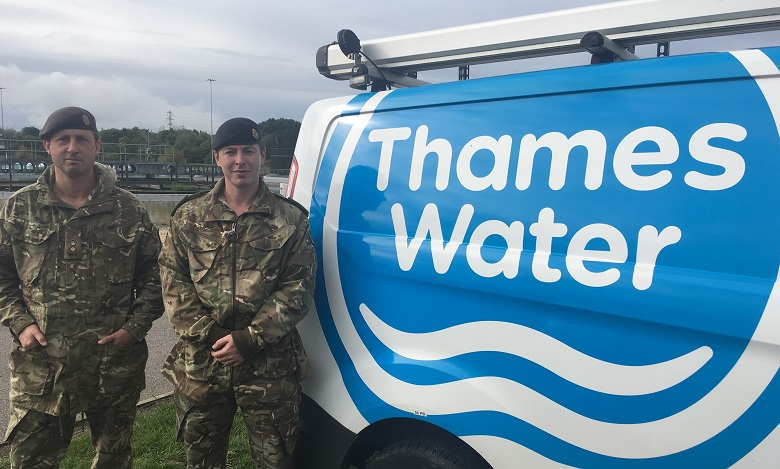 Two soldiers next to a Thames Water van