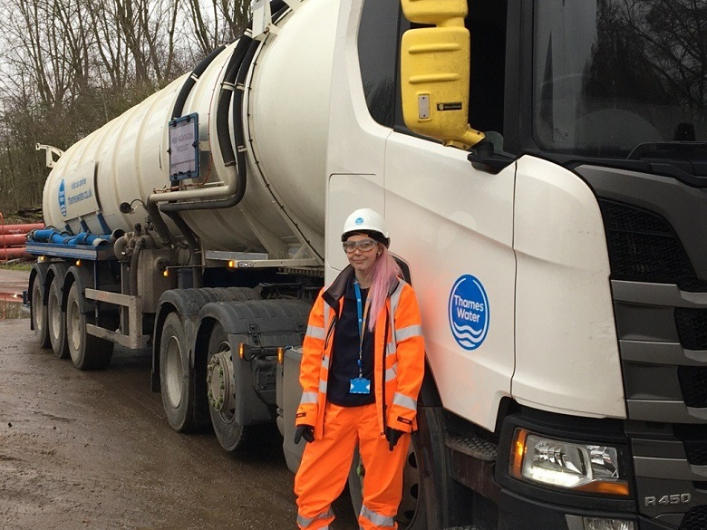 Lucianna standing infront of a Thames Water tanker lorry