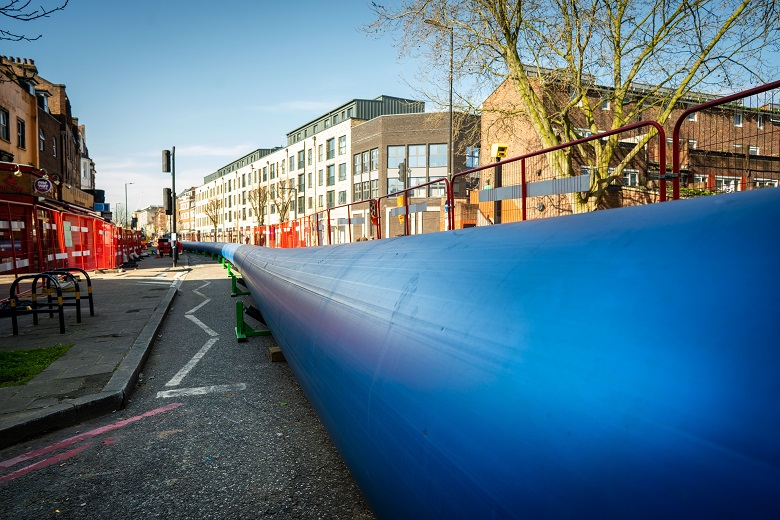 large blue water pipe ready for installation on London street