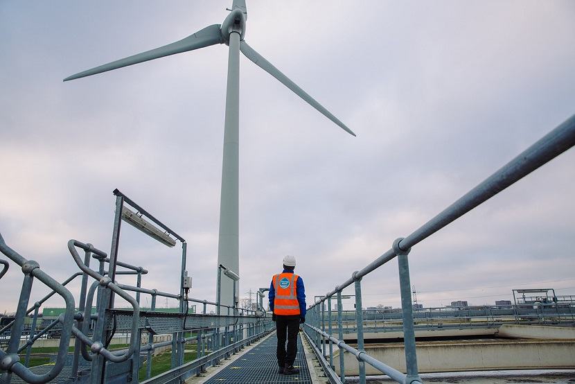 Thames Water employee looking at a wind turbine